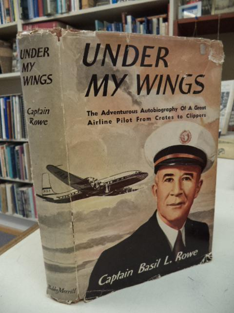 Under My Wings Rowe, Captain Basil L. Very Good Hardcover 256 pages. Jacket chipped at extremities, light staining to rear panel, price clipped, now in Brodart - a removable archival sleeve. Former owner's na