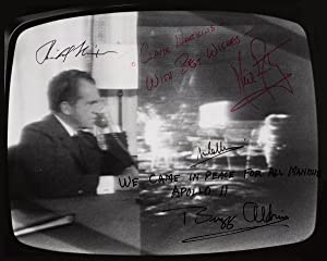 Photograph of a television screen, split, one: ARMSTRONG, NEIL, RICHARD