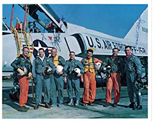 PHOTOGRAPH OF MERCURY SEVEN ASTRONAUTS SIGNED BY COOPER, GLENN, AND SLAYTON