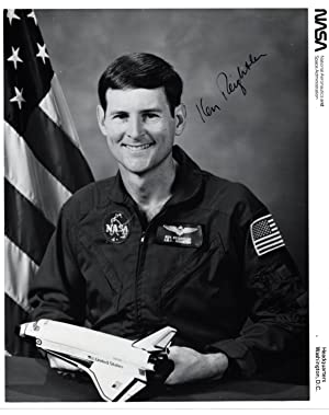SIGNED PHOTOGRAPH OF NASA SHUTTLE ASTRONAUT KEN REIGHTLER