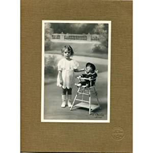 Vintage photo of a baby girl by Cauvin studio