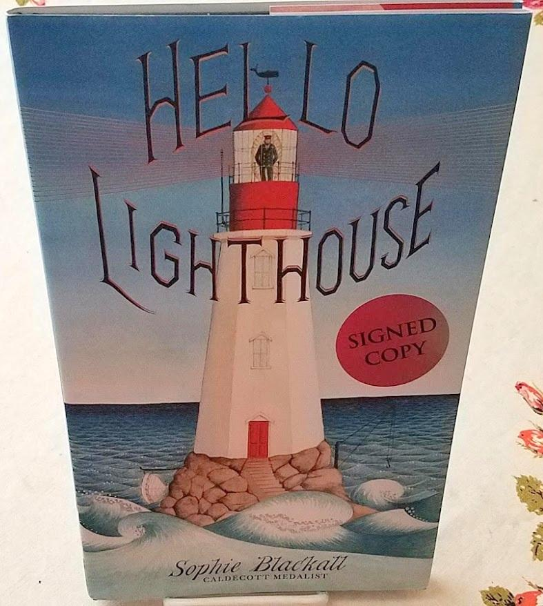 HELLO LIGHTHOUSE Blackall, Sophie [ ] [Hardcover] Hard Cover. Fine in a Fine dustjacket. Illustrated by author who also won the Caldecott Award for Finding Winnie. SIGNED by Blackall on the title page, Signed copy sticker on front cover of dustjacket. Caldecott Award Winner, no medal on dustjacket. Book is in unread condition.