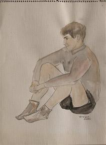 Portrait of a young man sitting.