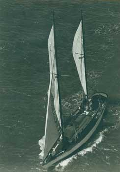 Aerial view of a two-masted sailboat.: Unidentified.
