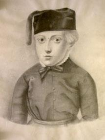 Portrait of a boy with a cap and tassle.
