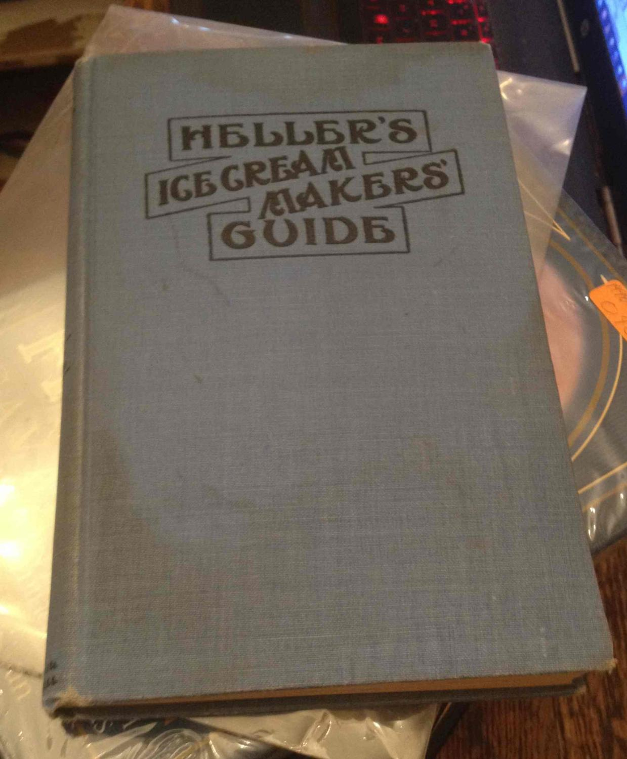 Heller's Ice Cream Makers' Guide -Fifth Edition- B. Heller & Co. [Satisfaisant] [Couverture rigide] 132pp.incl.adverts; HB blue w/blk.; rubbed w/dampstain&ripple,bttm.edge; dampstain,tp.edge; wear on edges&corners w/spine stained; some lt.ripple,bttm.edge; some lt.tan w/clean,tight pgs.  This, our fifth and most complete edition of Heller's Ice Cream Makers' Guide is intended to be not only a Guide for the beginner but an every day assistant to the expert and experienced ice cream maker.  illus. Size: 8vo - over 7¾  - 9¾  tall