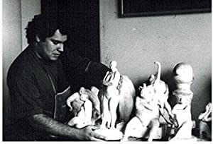Photograph of the Artist with sculptures holding la Mujer del Circo.