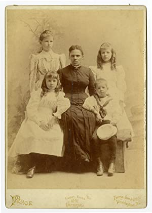 [LARGE CABINET CARD PHOTOGRAPH OF AN AFRICAN AMERICAN WOMAN AND FOUR WHITE CHILDREN]