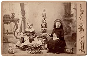 [Cabinet Card photo of children with toys ]