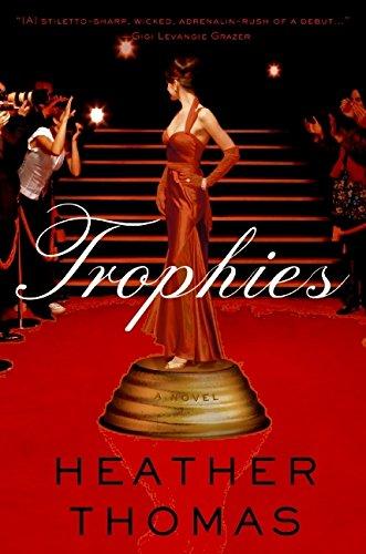 9780061580352: Trophies