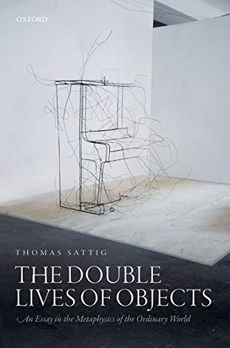9780199683017: The Double Lives of Objects: An Essay in the Metaphysics of the Ordinary World