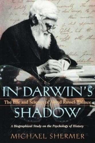 9780199856534: In Darwin's Shadow: The Life and Science of Alfred Russel Wallace