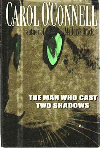 9780399140648: The Man Who Cast Two Shadows