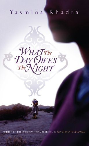 9780434019939: What the Day Owes the Night