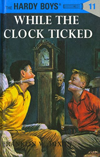 9780448089119: While the Clock Ticked (Hardy Boys, Book 11)