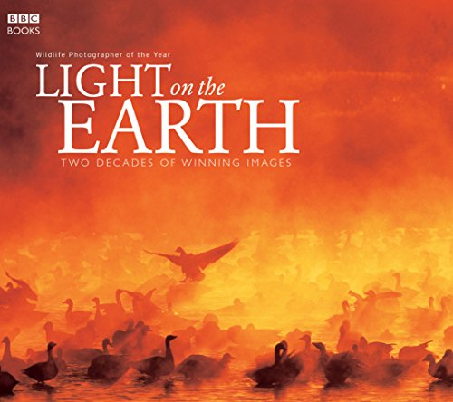 9780563522607: Light on the Earth: Two Decades of Winning Images (Wildlife Photographer of the Year)
