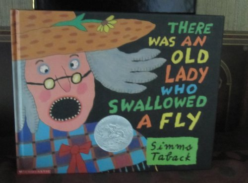 9780590631884: There Was an Old Lady Who Swallowed a Fly