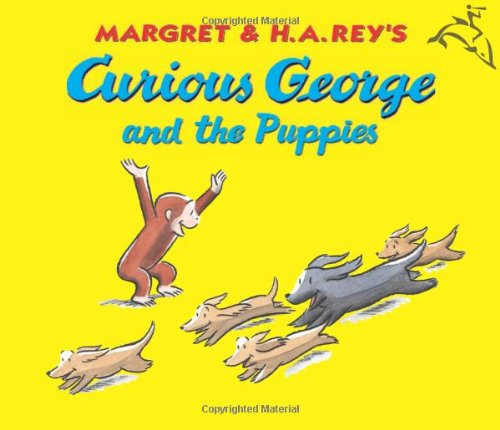 9780618564514: Curious George and the Puppies