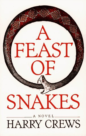 9780689707155: A Feast of Snakes