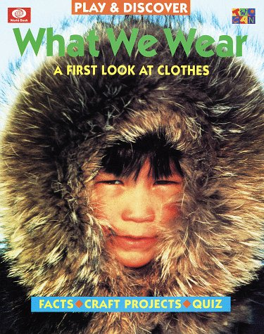 9780716648031: What We Wear: A First Look at Clothes (Play and Discover Series.)