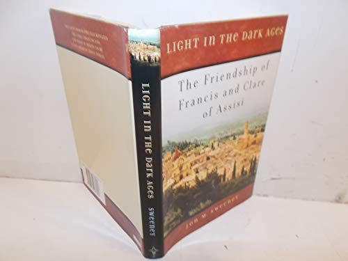 9780739487693: Light in the Dark Ages: The Friendship of Francis and Clare of Assisi First edition by Jon M. Sweeney (2007) Hardcover