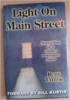 9780978555900: Light on Main Street: Storytelling by a Country Newspaper Editor
