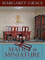 9781410418333: Malice in Miniature (Wheeler Cozy Mystery)