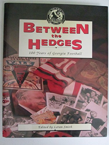 BETWEEN THE HEDGES : ONE HUNDRED YEARS OF GEORGIA FOOTBALL.: Smith, Loran.