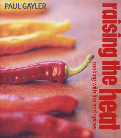 9781856263733: Raising the Heat: Cooking with Fire and Spice