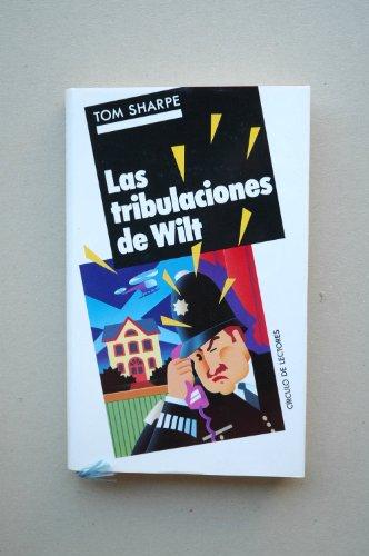 9788422627944: Las tribulaciones de Wilt / Tom Sharpe ; traducción de Marisol de Mora ; ilustraciones de la sobrecub. Albert Rocarols
