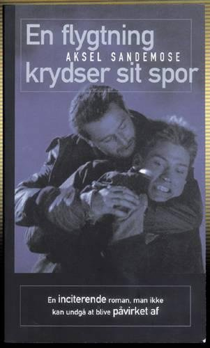 9788757014914: En flygtning krydser sit spor (in Danish)